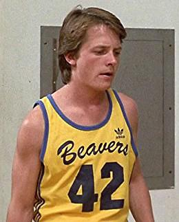 Michael J Fox as Scott Howard wearing Beavers 42 yellow tank top